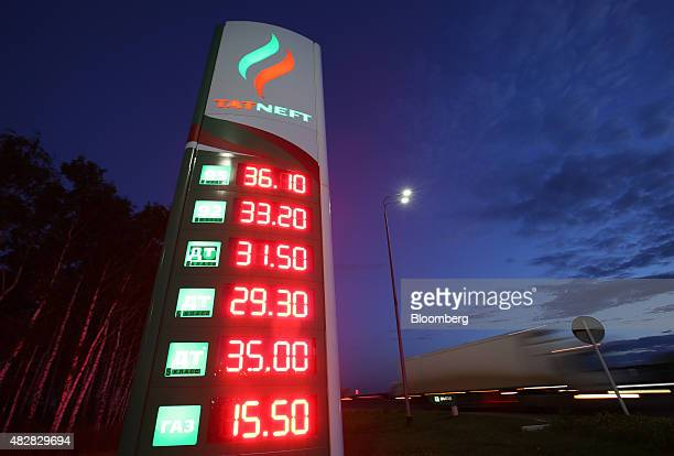 A fuel price sign sits illuminated at night outside a Tatneft OAO gas station on the M7 'Volga' highway near Kazan Russia on Sunday Aug 2 2015 The...