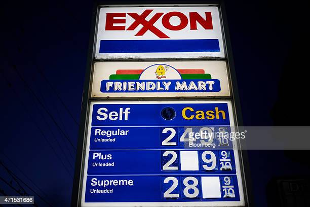 Fuel prices are displayed at an Exxon Mobil Corp gas station in Richmond Kentucky US on Wednesday April 29 2015 Exxon Mobil Corp is scheduled to...