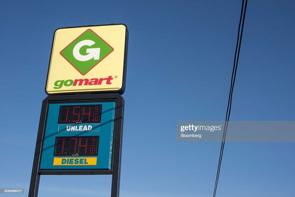 Fuel prices are displayed on a sign outside a Go Mart Inc. gas station in Rockbridge, Ohio, U.S., on Saturday, Feb. 6, 2016. Thanks to a glut of oil that has spurred refiners to make as much fuel as they can, pump prices nationwide are down about 26 cents a gallon from a year ago, which is translating into almost $80 million a day in savings for U.S. drivers, according to Michael Green, a spokesman in Washington for AAA. Photographer: Ty Wright/Bloomberg via Getty Images