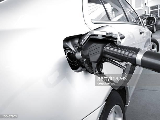 Fuel pump nozzle in a car tank