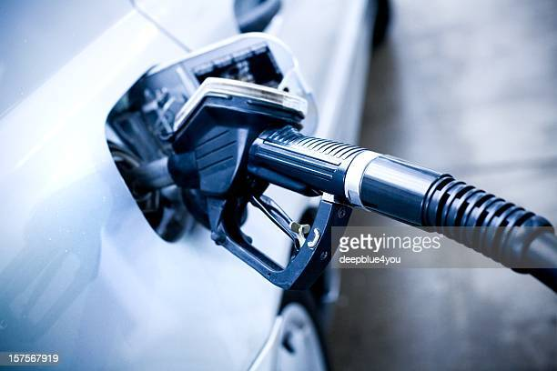 fuel pump nozzle in a car tank - land vehicle stock pictures, royalty-free photos & images