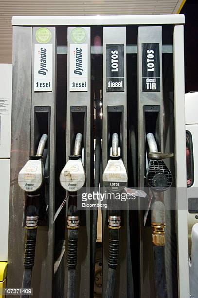 Fuel pump nozzles are seen at a Grupa Lotos SA gas filling station seen in Gdansk Poland on Monday Dec 6 2010 Russian companies such as OAO Gazprom's...