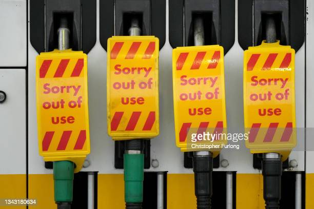 """Fuel pumps are marked """"Sorry out of use"""" as a Shell petrol station waits for a delivery on September 27, 2021 in Northwich, United Kingdom. The..."""