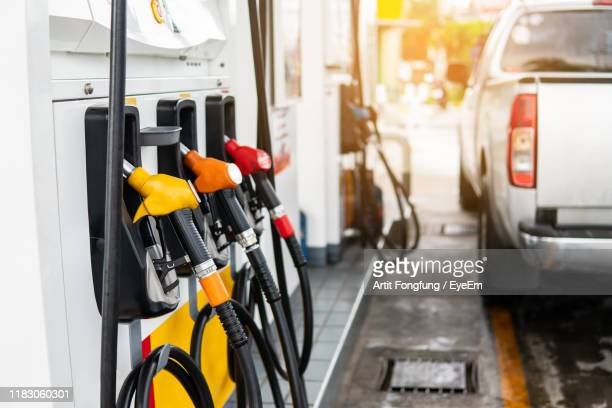 fuel pumps at gas station - gas station stock pictures, royalty-free photos & images