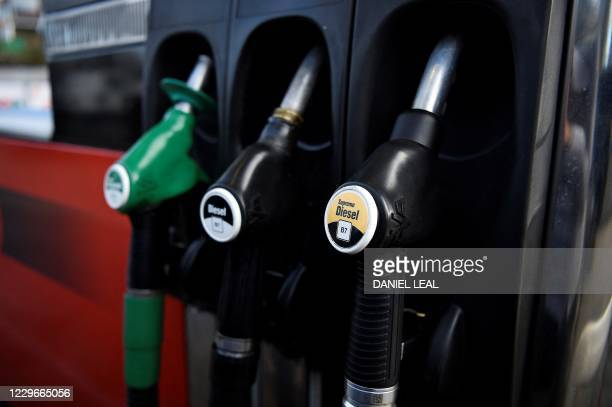Fuel pumps for unleaded and diesel fuels are pictured at a petrol station in north London on November 18, 2020. - Britain will ban petrol and diesel...