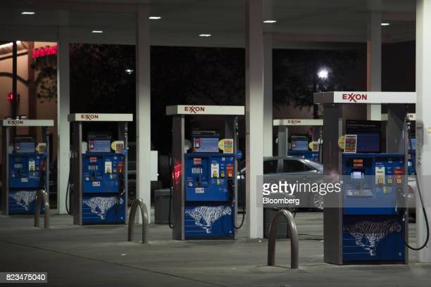 Fuel pumps stand at an Exxon Mobil Corp gas station in Dallas Texas US on Monday July 24 2017 Exxon Mobil Corp is scheduled to release earnings...