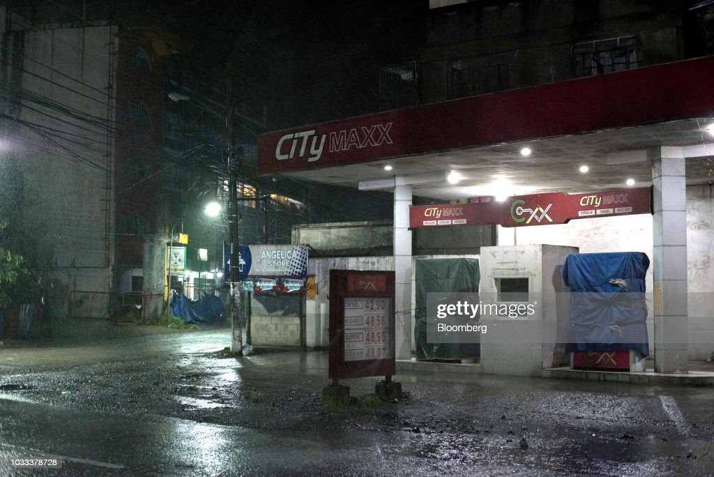 Fuel pumps stand covered in tarpaulin at a gas station ahead of Typhoon Mangkhut's arrival in Tuguegarao, Cagayan province, the Philippines, on Friday, Sept. 14, 2018. Super Typhoon Mangkhut is expected to threaten Chinas Guangdong coastline, and Hong Kong, with a possible direct strike that may cause as much as $120 billion in damage and economic losses. Photographer: Carlo Gabuco/Bloomberg via Getty Images