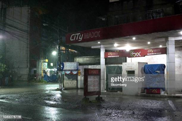 Fuel pumps stand covered in tarpaulin at a gas station ahead of Typhoon Mangkhut's arrival in Tuguegarao Cagayan province the Philippines on Friday...