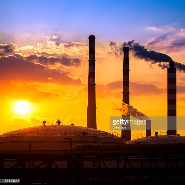Fuel storage area and power plant at sunset