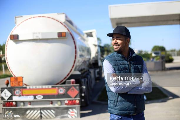 fuel tanker driver - gas station stock pictures, royalty-free photos & images