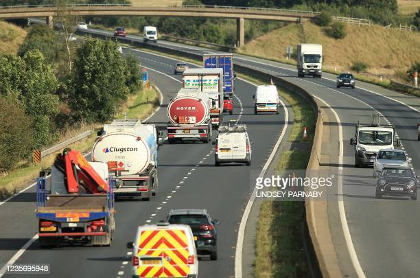 Fuel tanker drivers drive their lorries laden with petrol fuel along the M180 motorway in near the Prax Lindsey Oil Terminal in North Killingholme,...