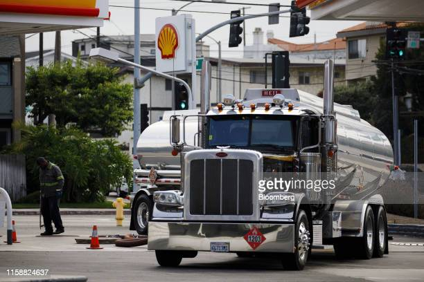 A fuel tanker truck driver delivers gasoline at a Royal Dutch Shell Plc gas station in Redondo Beach California US on Sunday July 28 2019 Royal Dutch...