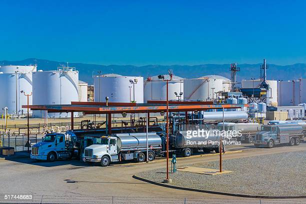 fuel tanker trucks - storage tank stock photos and pictures