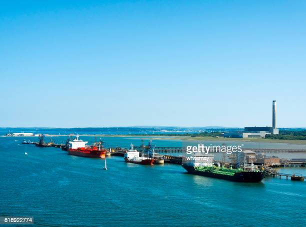 fuel tankers moored in southampton water, england - southampton england stock photos and pictures