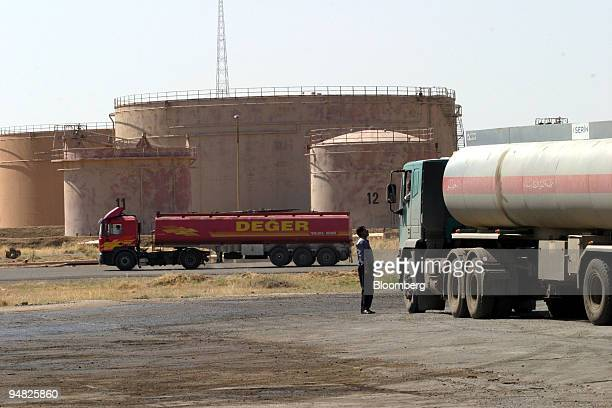 Fuel tankers queue to load refined oil products from a facility in the Kirkuk northern Iraq region Tuesday May 18 2004 OPEC's plan to boost oil...