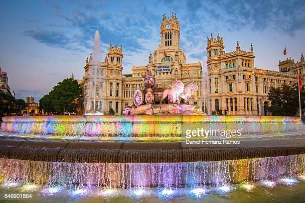 Fuente de Cibeles and palacio de Comunicaciones illuminated at twilight in Madrid Spain