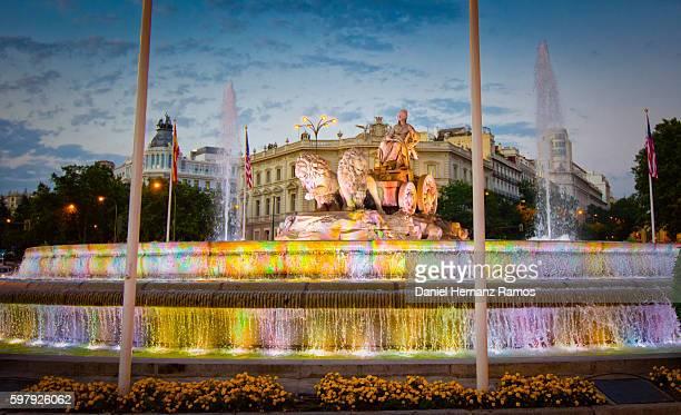 Fuente de Cibeles illuminated at twilight in Madrid Spain