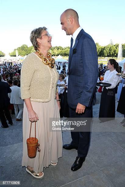 Fuerstin Gloria von Thurn und Taxis and her son Prince Albert von Thurn und Taxis laugh during the Summer Reception of the Bavarian State Parliament...