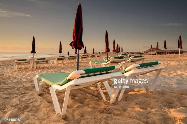 Fuerteventura, sunrise over empty sand beach