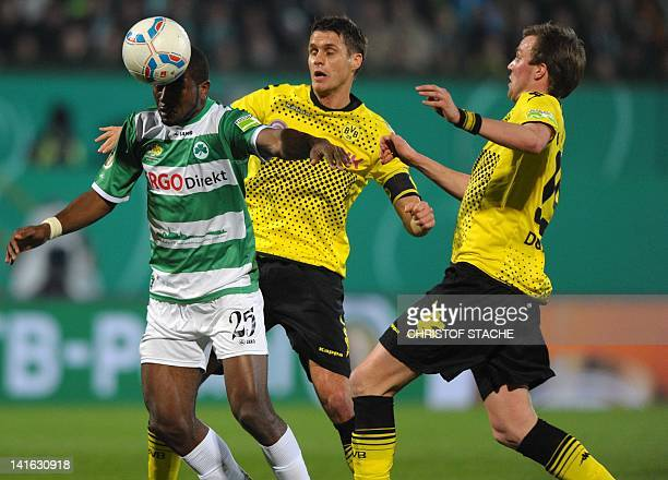 Fuerth's Canadian striker Olivier Occean vies for the ball with Dortmund's midfielder Sebastian Kehl and Dortmund's midfielder Kevin Grosskreutz...