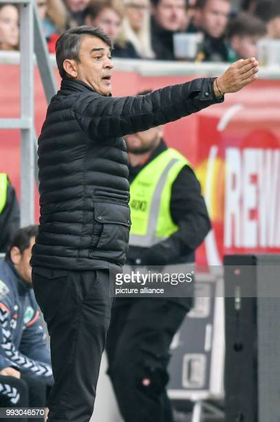 Fuerth's coach Damir Buric gives orders to his team on the sideline during the German 2nd division Bundesliga soccer match between Jahn Regensburg...