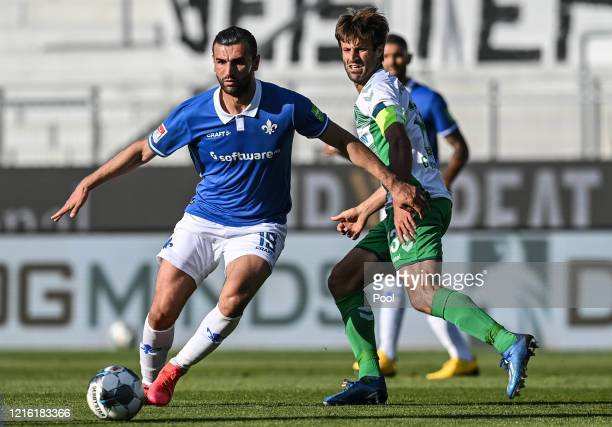 Fuerth's Marco Caligiuri battles for possession with Darmstadt's Serdar Dursun during the Second Bundesliga match between SV Darmstadt 98 and SpVgg...