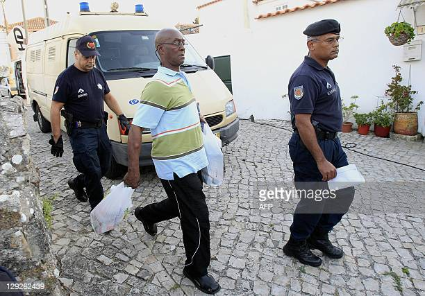 US fugitive George Wright arrives home in Almocageme near Sintra on the outskirts of Lisbon on October 14 2011 A Portuguese court has placed Wright...