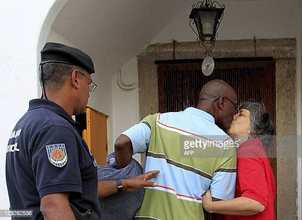 US fugitive George Wright kisses his wife Maria do Rosario as he arrives home in Almocageme near Sintra on the outskirts of Lisbon on October 14 2011...