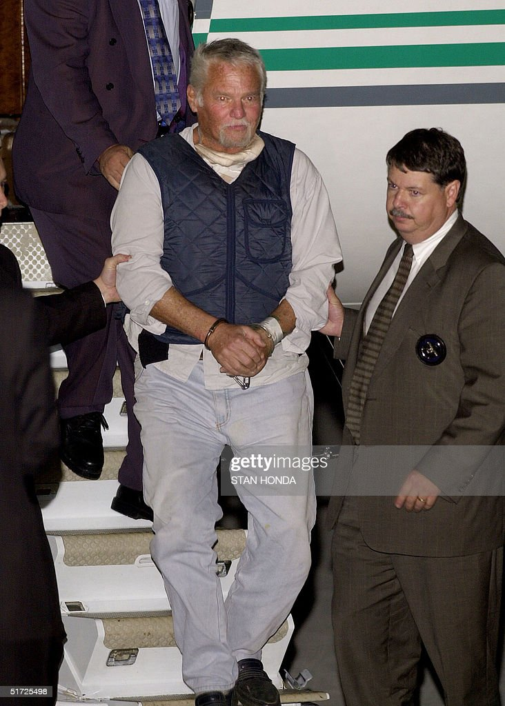 US fugitive Ira Einhorn is escorted in handcuffs o : News Photo