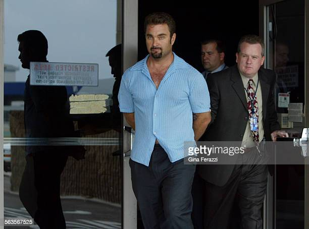 Fugitive rapist Andrew Luster is led out of the US Customs building after arriving at LAX in federal custody Thursday June 19 2003 Luster was caught...