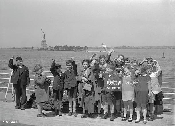 Fugitives from Nazi Austria, land of their birth, these children have a first sight of the Statue of Liberty where they will start life anew. These...