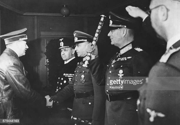 Fuhrer Adolf Hitler shaking hands with a group of German officers Admiral Erich Raeder Walther von Brauchitsch Wilhelm Keitel and Heinrich Himmler...