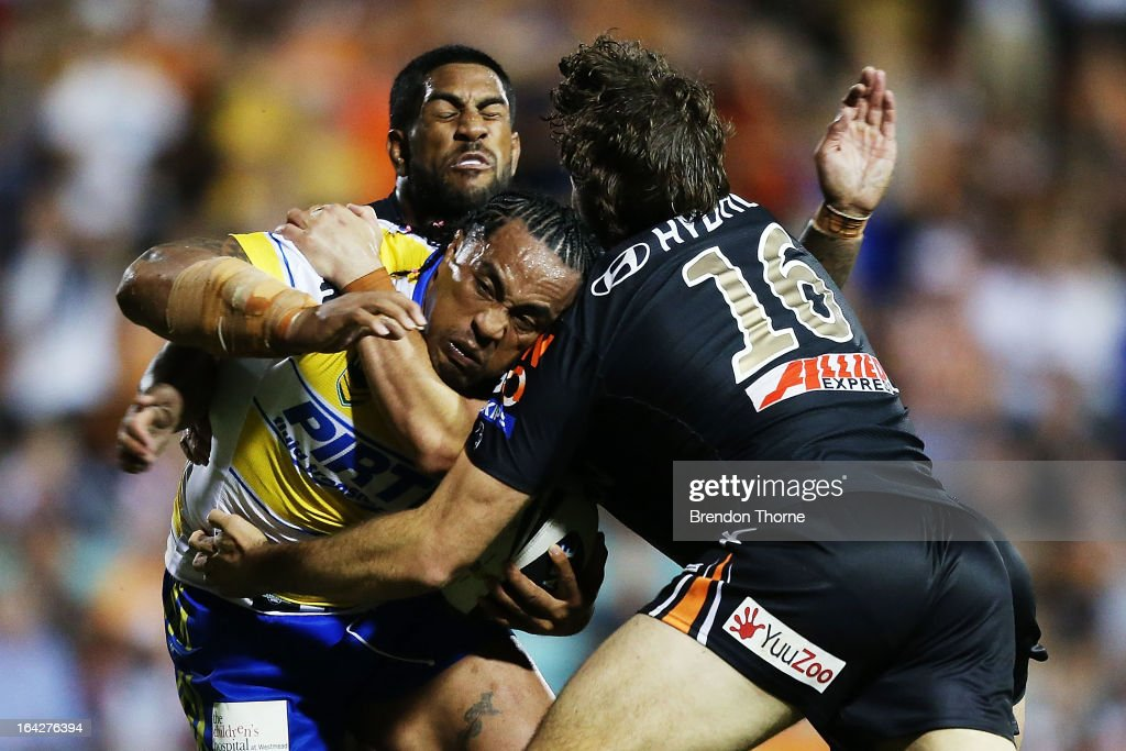 Fuifui Moimoi of the Eels is tackled by Matt Bell and Eddy Pettybourne of the Tigers during the round three NRL match between the Wests Tigers and the Parramatta Eels at Leichhardt Oval on March 22, 2013 in Sydney, Australia.