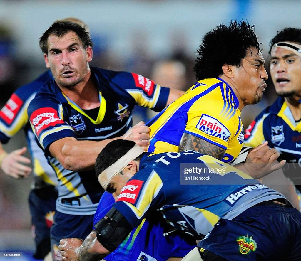 Fuifui Moimoi of the Eels is tackled by Scott Bolton and Willie Tonga of the Cowboys during the round seven NRL match between the North Queensland Cowboys and the Parramatta Eels at Dairy Farmers Stadium on April 23, 2010 in Townsville, Australia.
