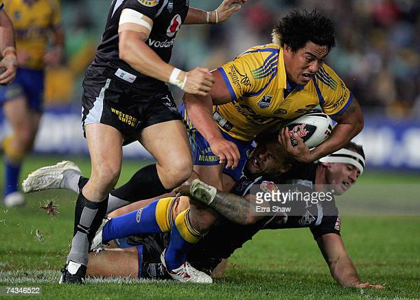 Fuifui Moimoi of the Eels is tackled by the Warriors during the round 11 NRL match between the Parramatta Eels and the Warriors at Parramatta Stadium...