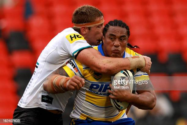 Fuifui Moimoi of the Eels is tackled during the NRL Trial match between the Penrith Panthers and the Parramatta Eels at Centrebet Stadium on February...