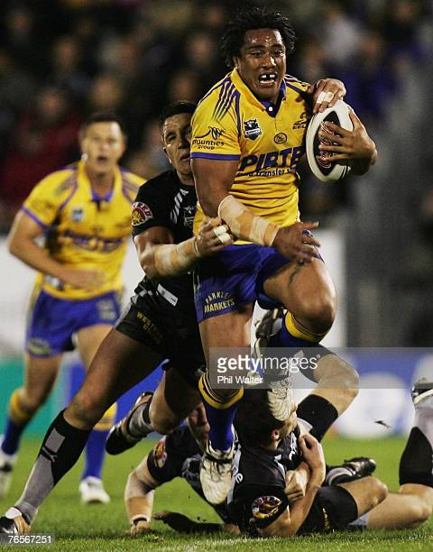 Fuifui Mormor of the Parramatta Eels is tackled by Steve Price of the Warriors during the NRL qualifying final match between the Warriors and the...