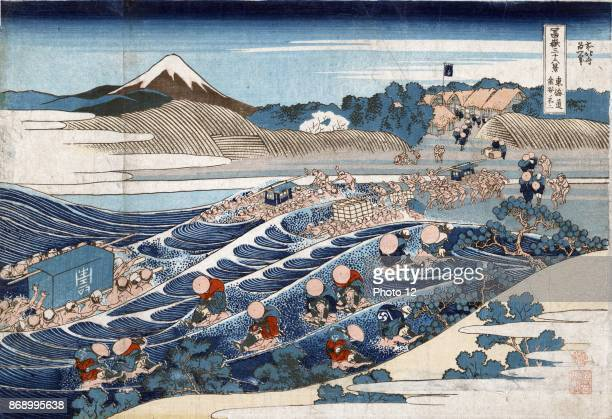 Fuji at Kanaya on the Tokaido Print shows porters carrying litters sedan chairs and individual persons across the river near the Kanaya station on...