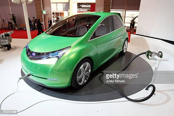 Fuji Heavy Industries Ltd's vehicle with the next generation Lithium-Ion battery is charged during the press day of the 40th Tokyo Motor Show at...