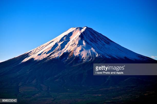 fuji in the morning sun - mount fuji stock photos and pictures