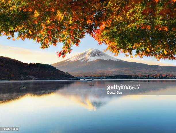 Fuji Mountain and Fisherman with Colourful Maple Tree in Autumn at Kawaguchiko Lake