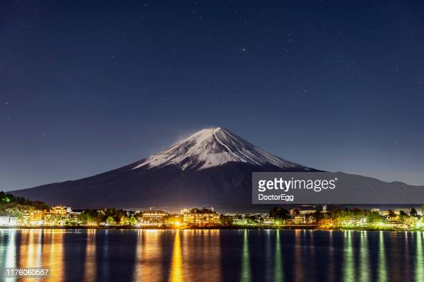 fuji mountain and light of fujikawagichiko town in winter, kawaguchiko lake, japan - yamanashi prefecture stock pictures, royalty-free photos & images