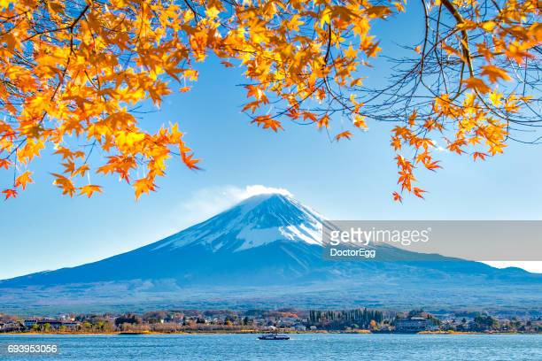 Fuji Mountain and Maple Leaves with Tourist Ship in Kawaguchiko Lake