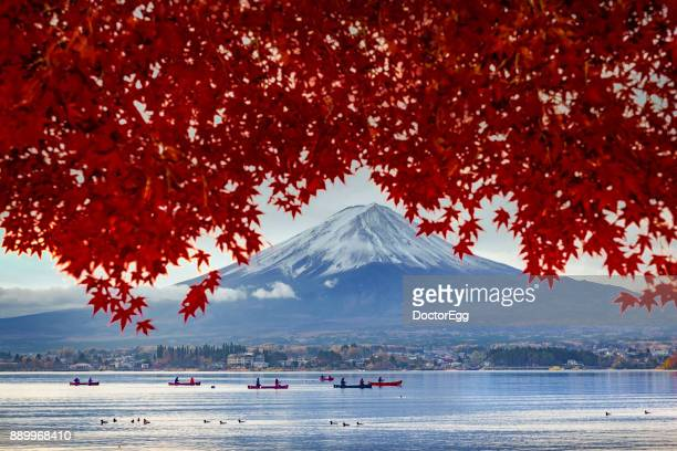 Fuji Mountain and Red Maple Tree with Tourist Boat in Kawaguchiko Lake in Autumn