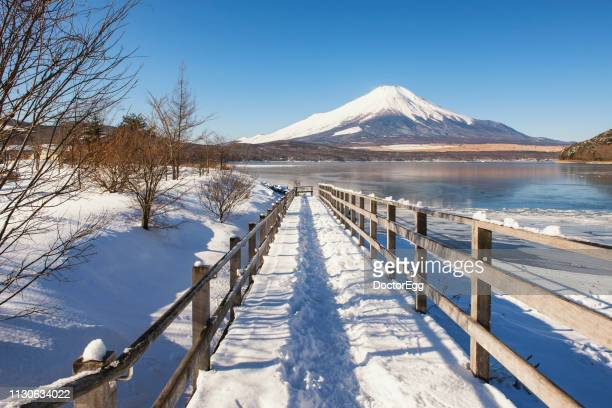 Fuji Mountain in Winter Snow Day at Yamanaka Lake, Japan