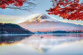 Fuji Mountain , Red Maple Tree and Fisherman Boat with Morning Mist in Autumn, Kawaguchiko Lake, Japan
