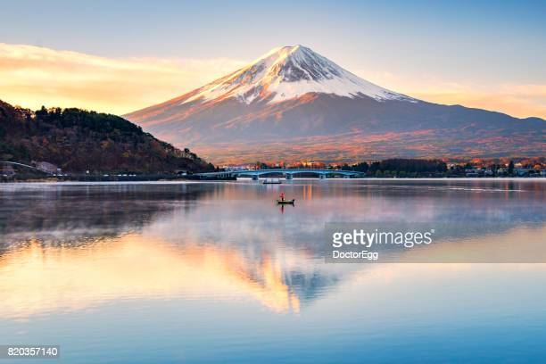 Fuji Mountain Reflection and Fisherman fishing on the boat in the Morning
