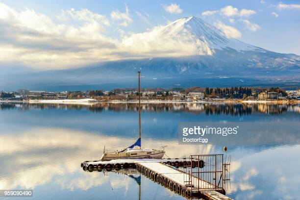 fuji mountain reflection and yacht pier in winter cloudy day at kawaguchiko lake - hokkaido stock pictures, royalty-free photos & images