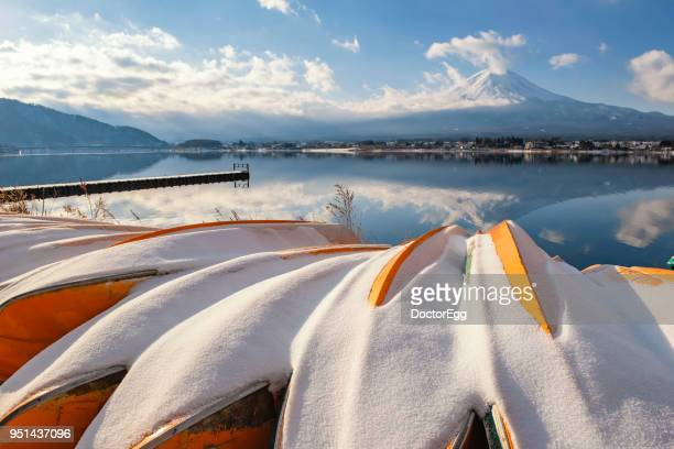 Fuji Mountain Reflection and Yellow Tourist Boat with Snow at Kawaguchiko Lake in Winter
