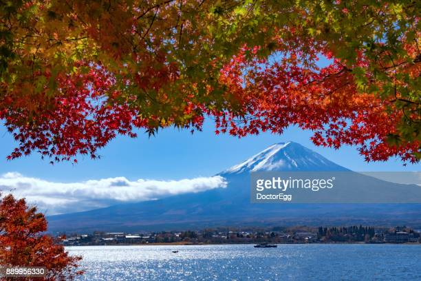 Fuji Mountain with Maple Leaves and Ensoleille Sightseeing Boat in Kawaguchiko Lake in Autumn